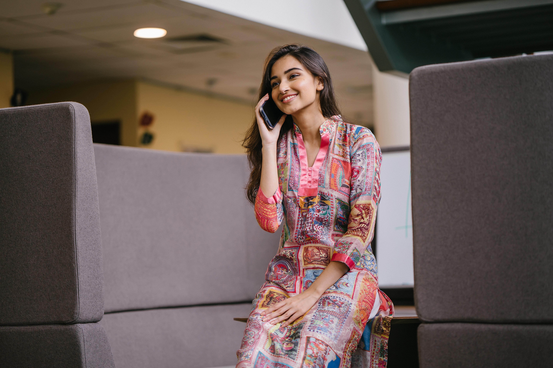 photo-of-smiling-woman-in-floral-salwar-kameez-talking-on-2559055